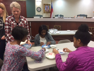 MYAC giving back by making beaded bracelets